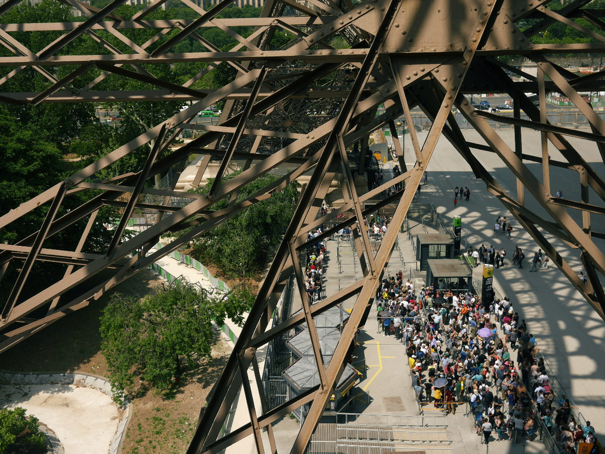 View from Eiffel Tower stairs, looking down on the queue for the lift